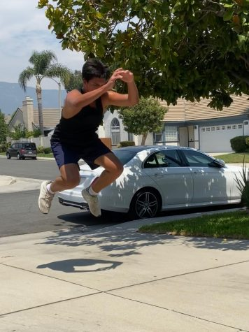 Junior James Rivera completes gorilla jumps in his driveway to stay in shape for baseball.