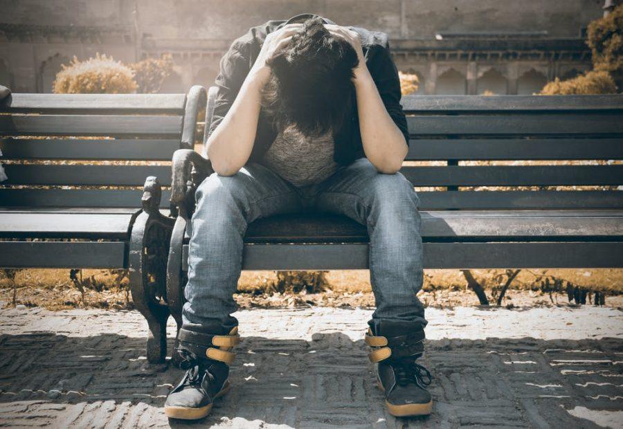 A+boy+stressing+on+a+bench+
