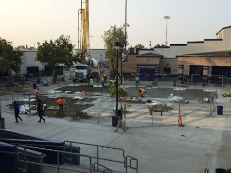Construction crews pour concrete in the RCHS quad to prepare the site for shade structures.